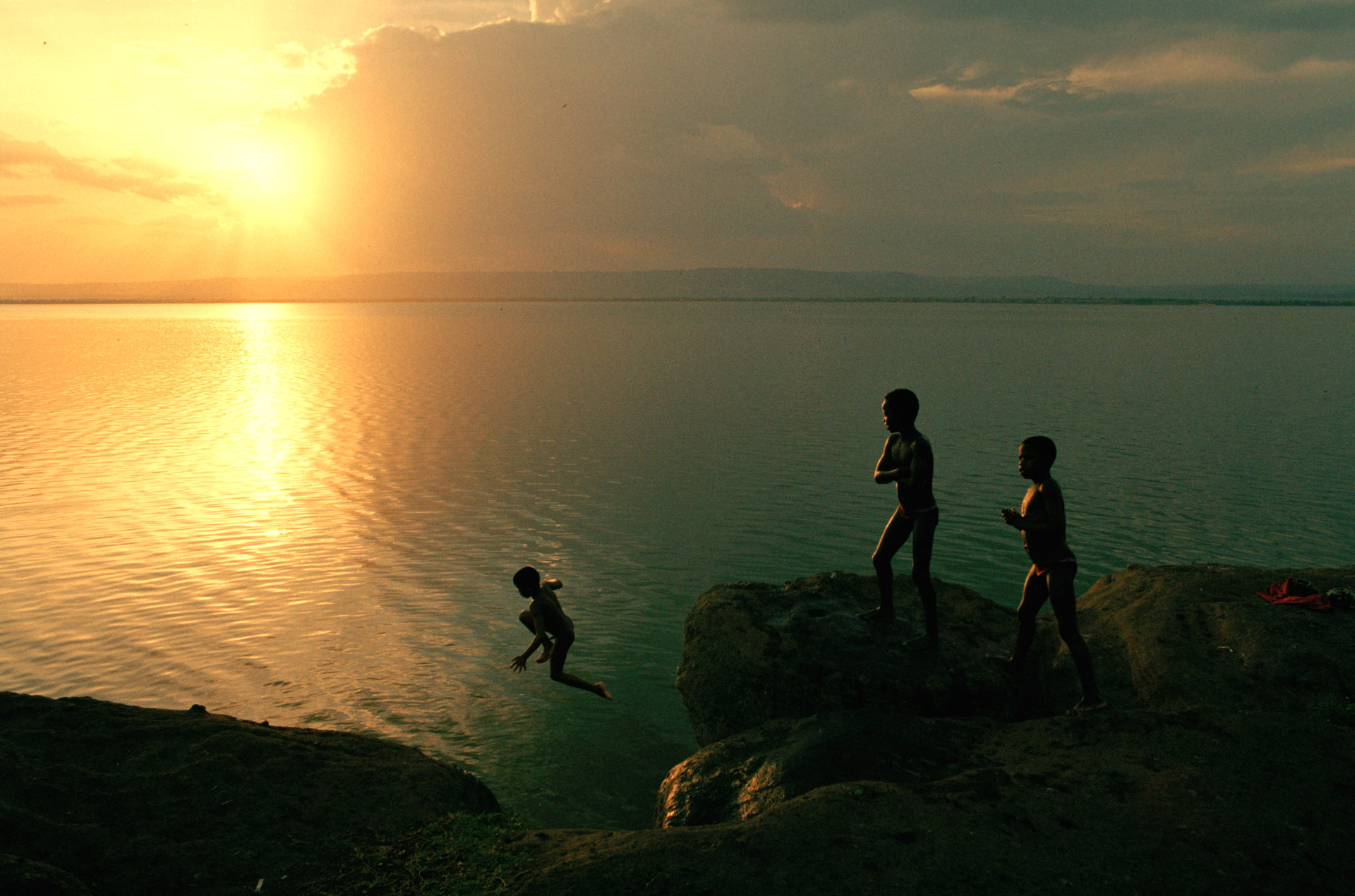 Boys jumping into the lake in Amora Gedel Park in Hawassa