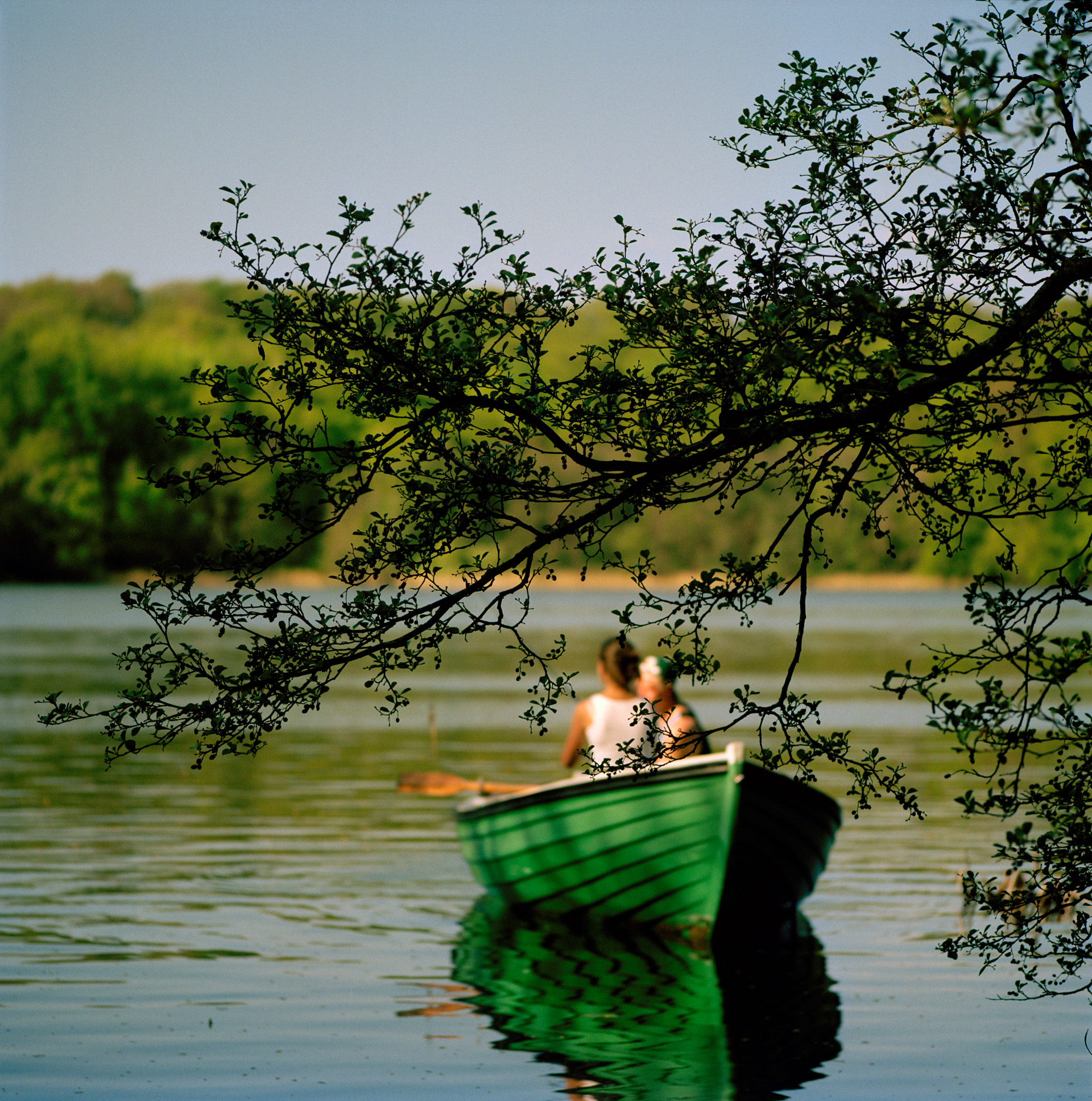 A couple in a rowing boat on Bagsværd Lake