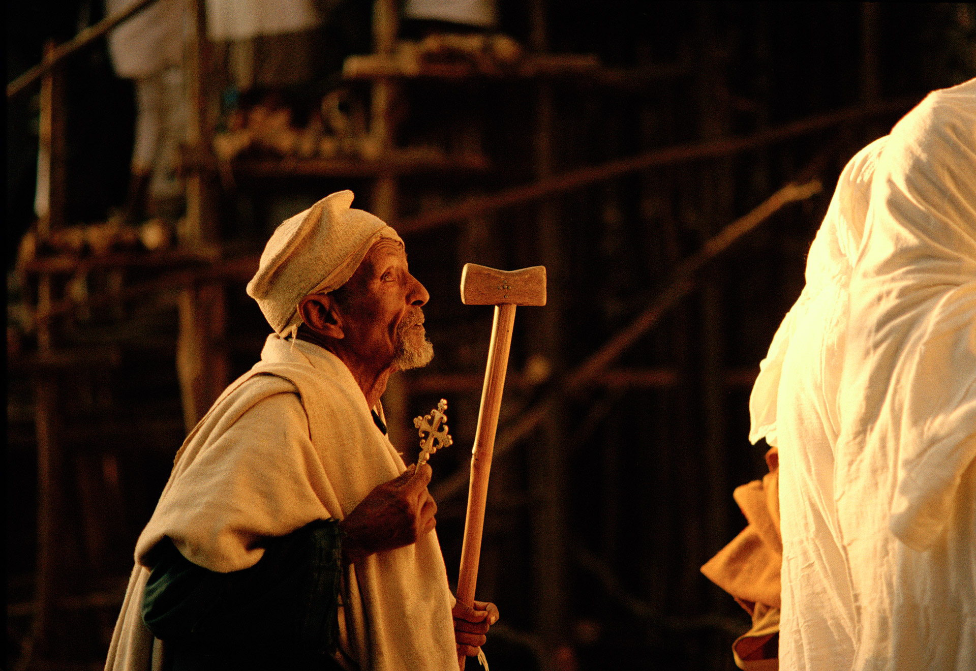 Old man holding a cross at Timkat religious Festival in Gondar Ethiopia