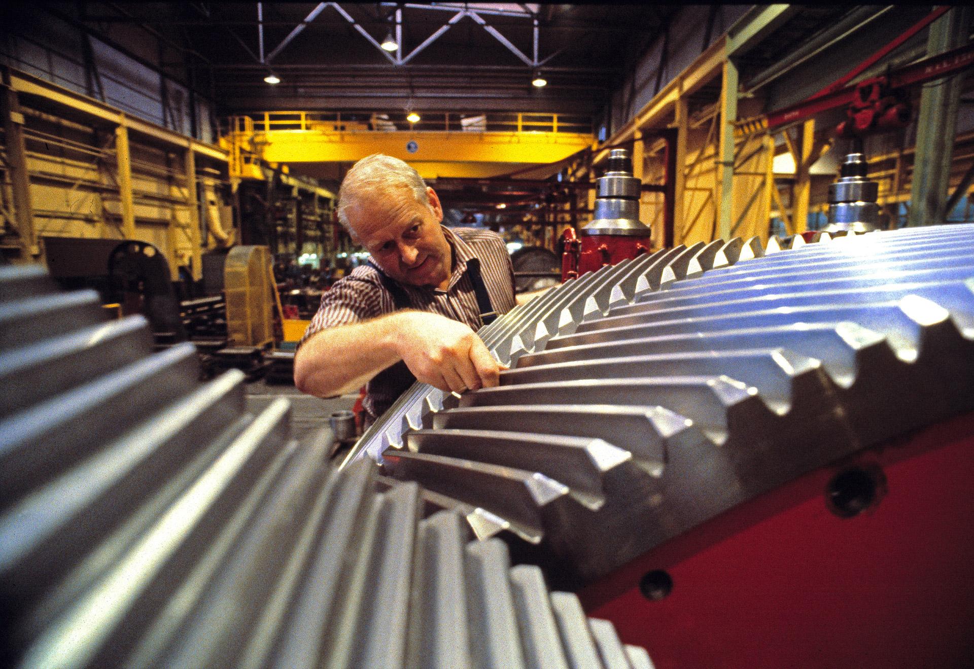 An employee checks the gear at FLS Industries in Copenhagen, Denmark