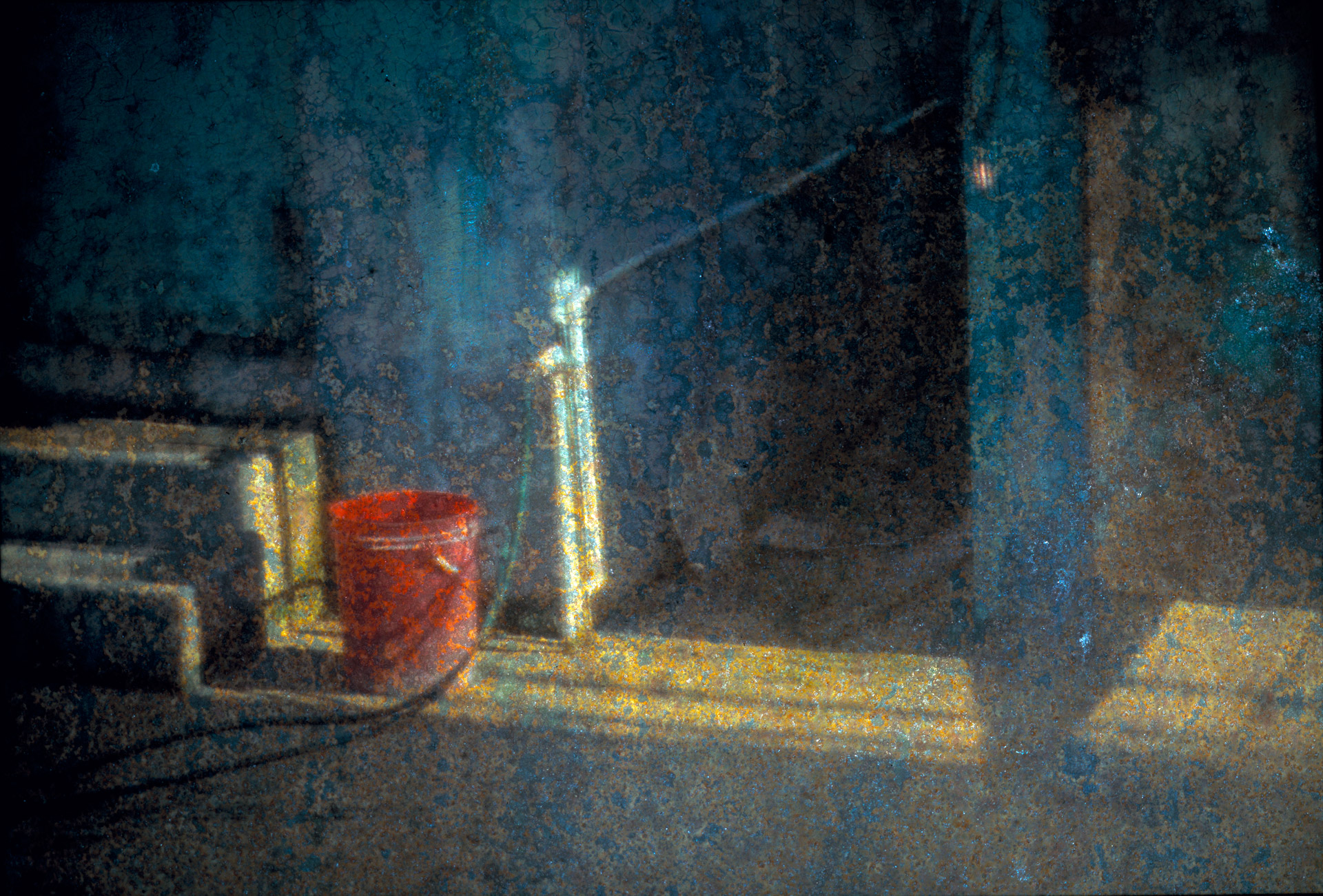 Red Bucket and blue walls-Placencia in Belize - image projected on weathered iron plate
