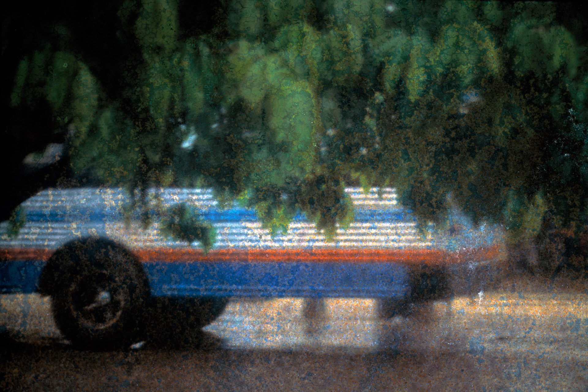 A local bus on a rainy day in Placencia in Southern Belize.
