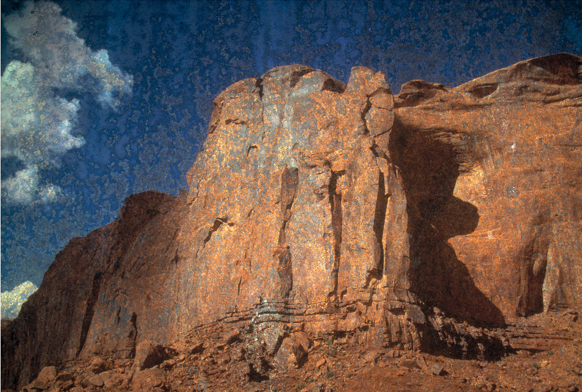 Rock formations in Monument Valley on iron plate