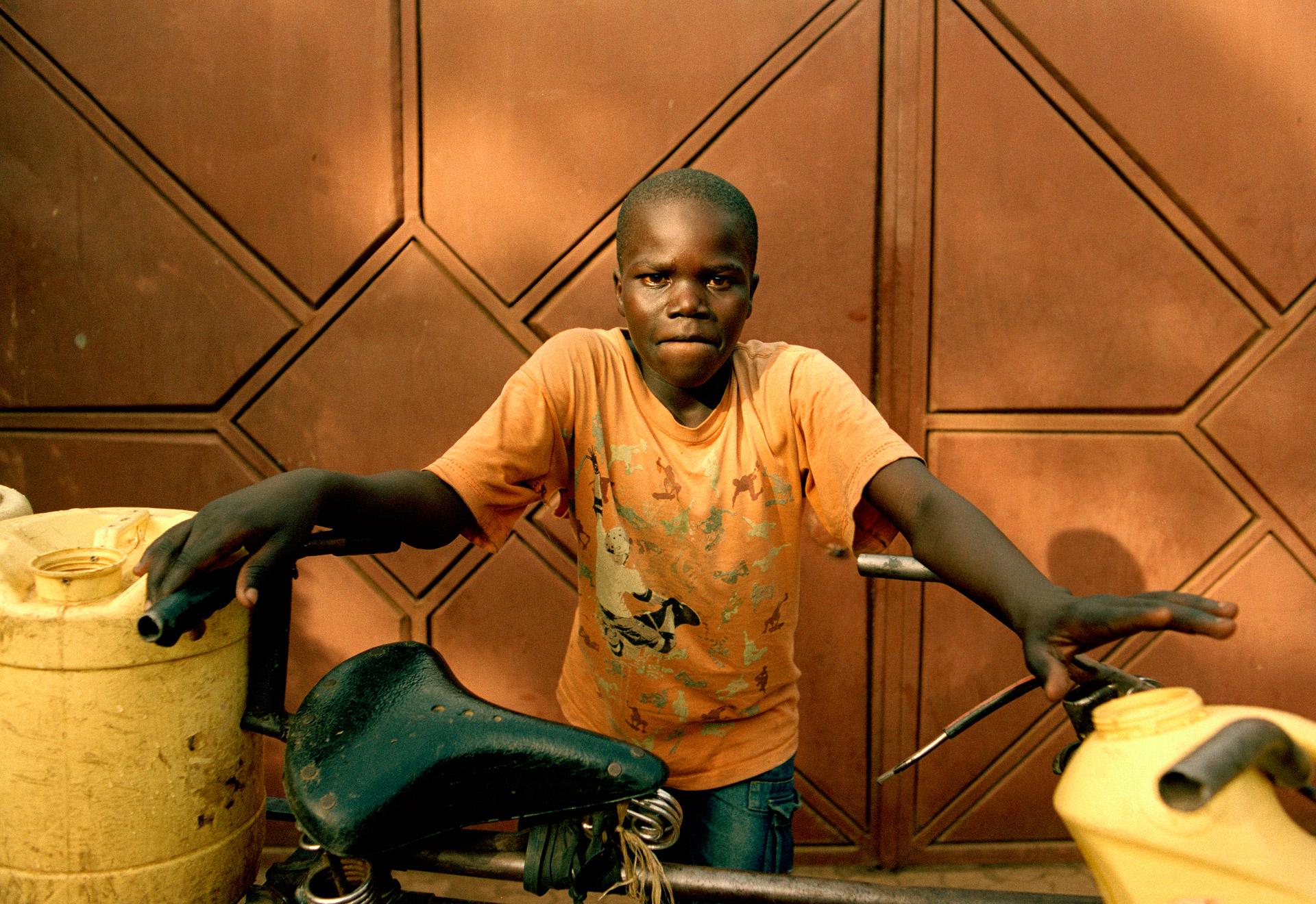 A boy fetching water in Kenya