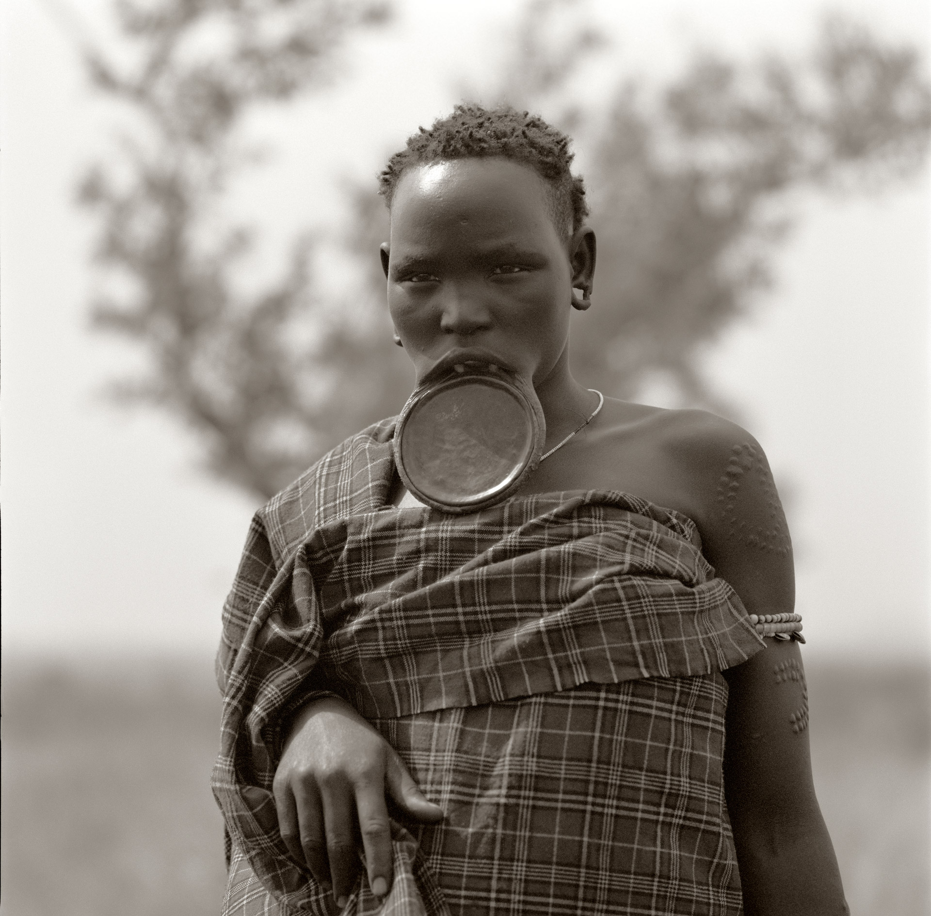 A woman from the Mursi tribe wearing a lip plate