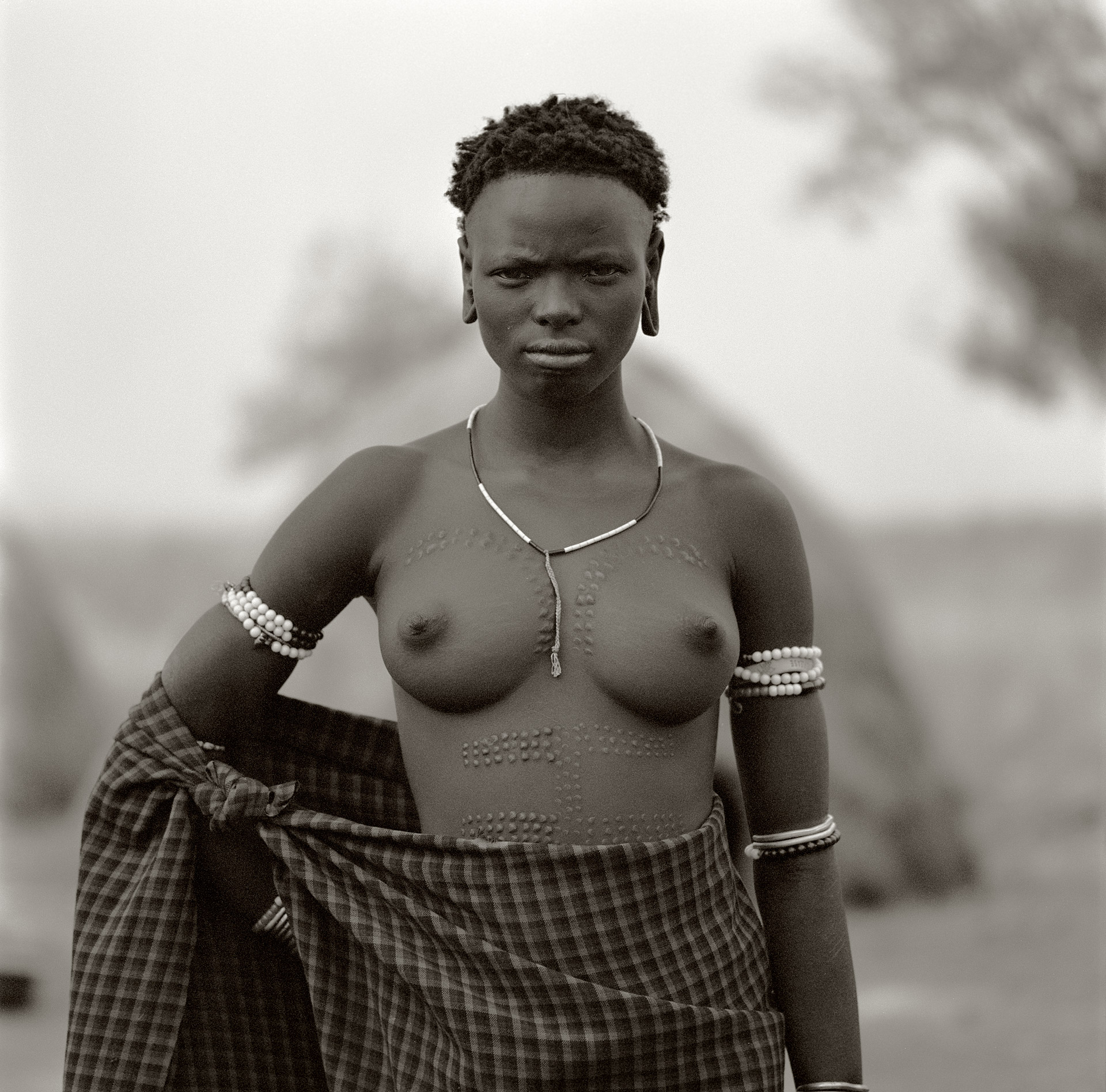A woman from the Mursi tribe in Omo Valley showing her beautiful scarification on her body