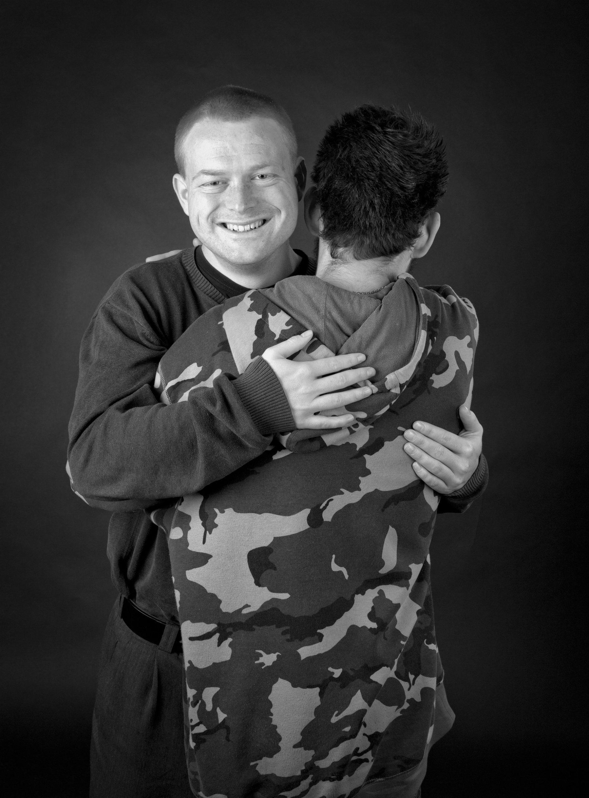 Two men hugging eachother