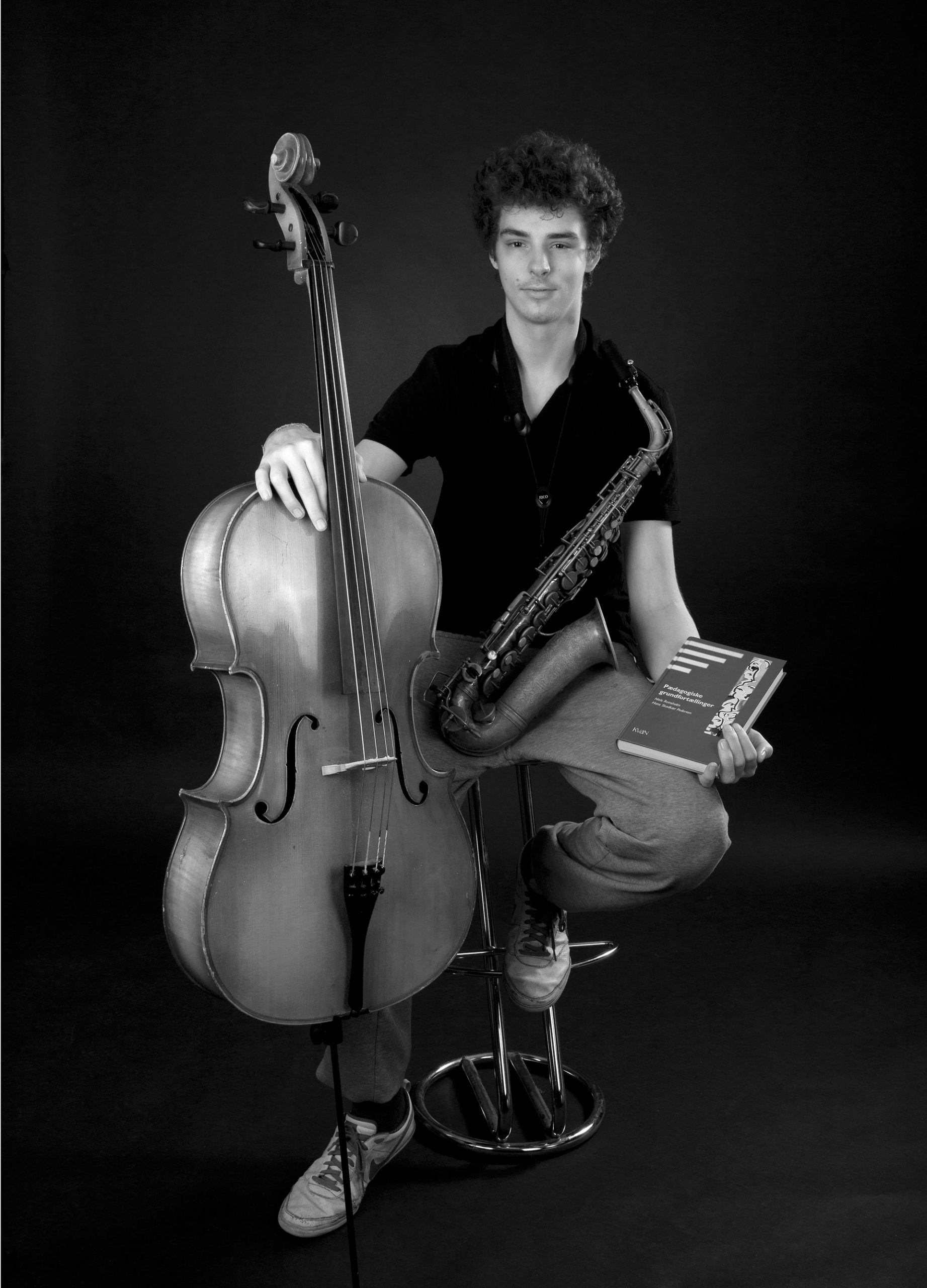 Young man with a cello and a saxophone.
