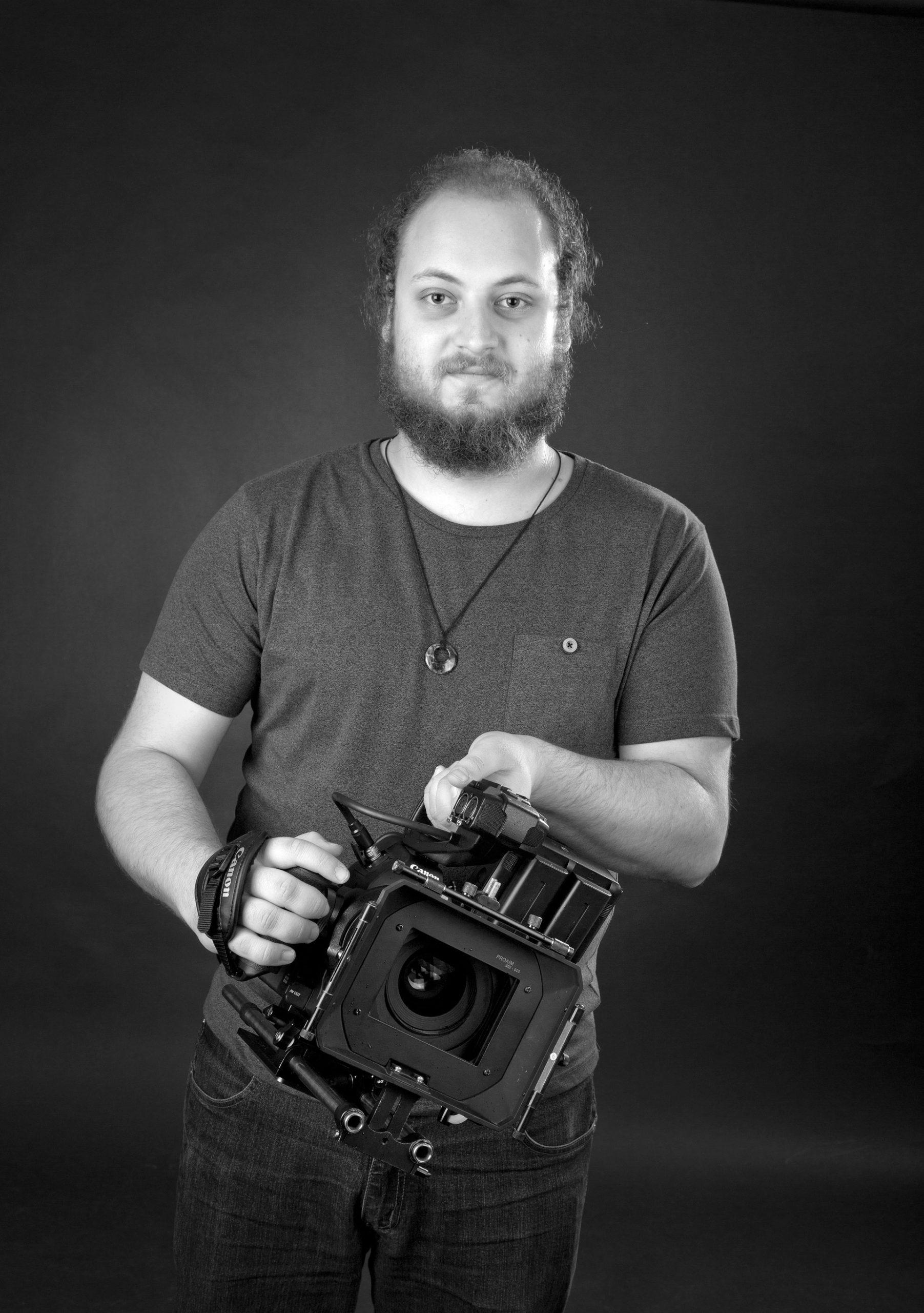 A man holding a video camera