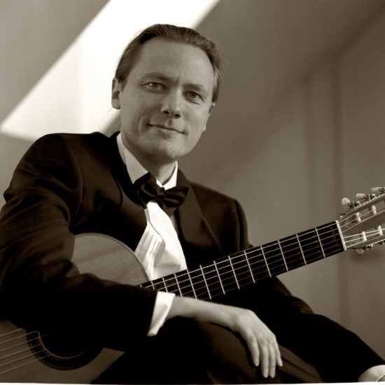 Danish classical guitarist Mikkel Andersen with his guitar