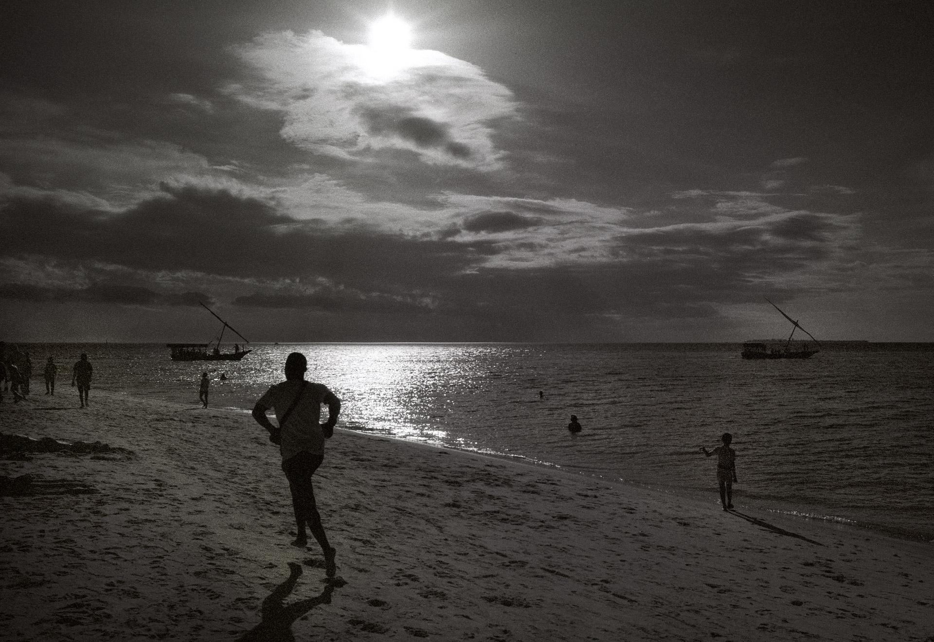 Man jogging on the beach in Stone Town on Zanzibar