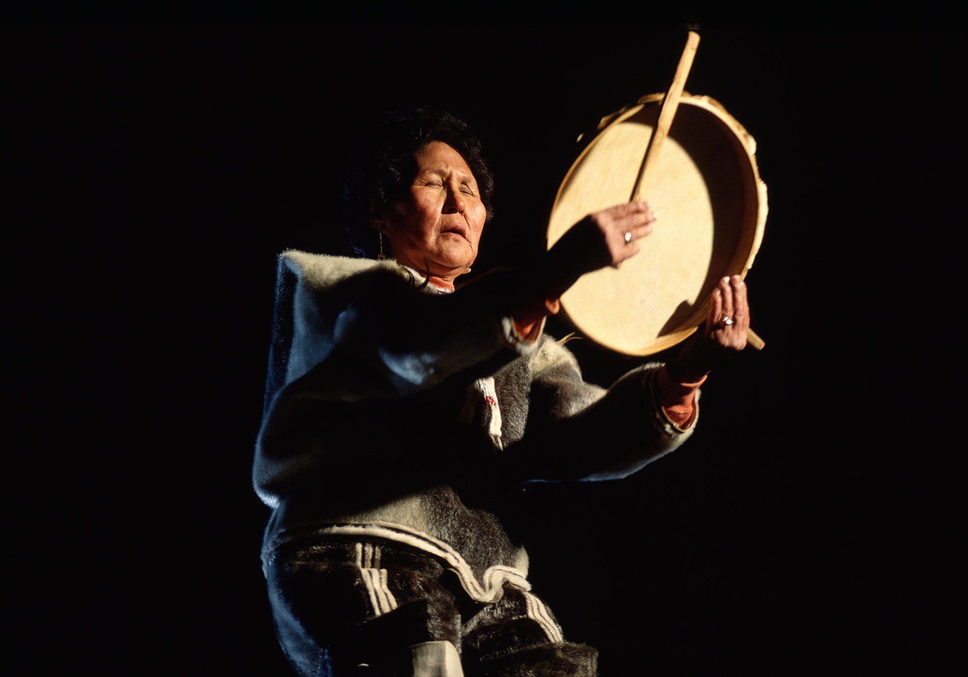 A drum dancer performs a ritual ceremony in Ammassalik in Greenland