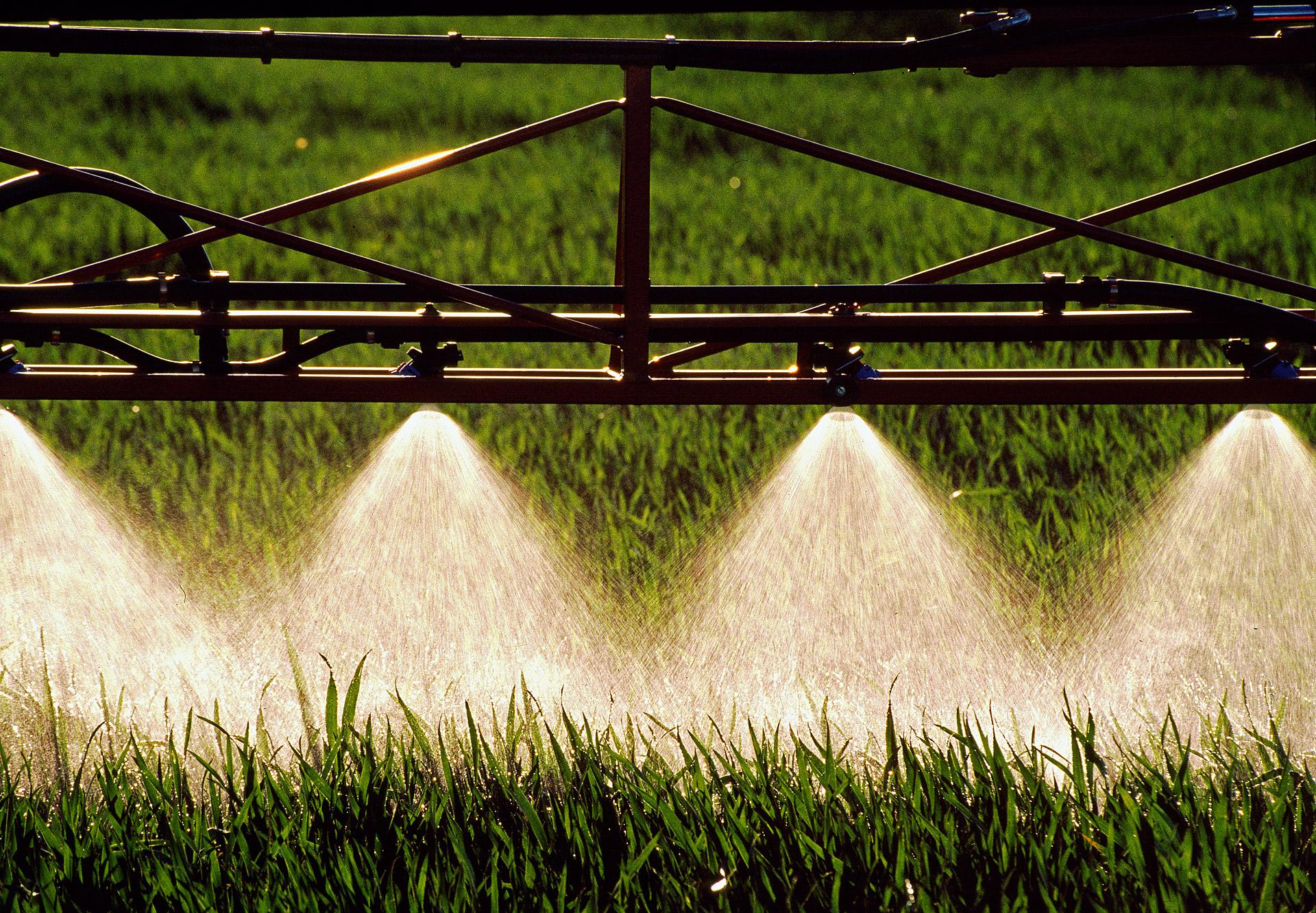 Pesticides are being sprinkled onto some crops. Hardi International