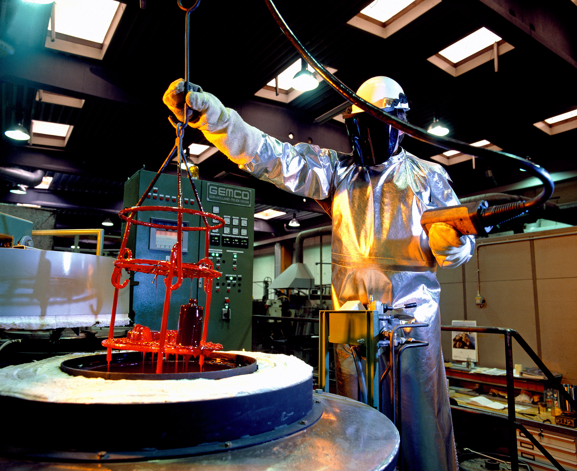 A man in a heat protective suit at a melting oven at jernkontoret, FLS Industries