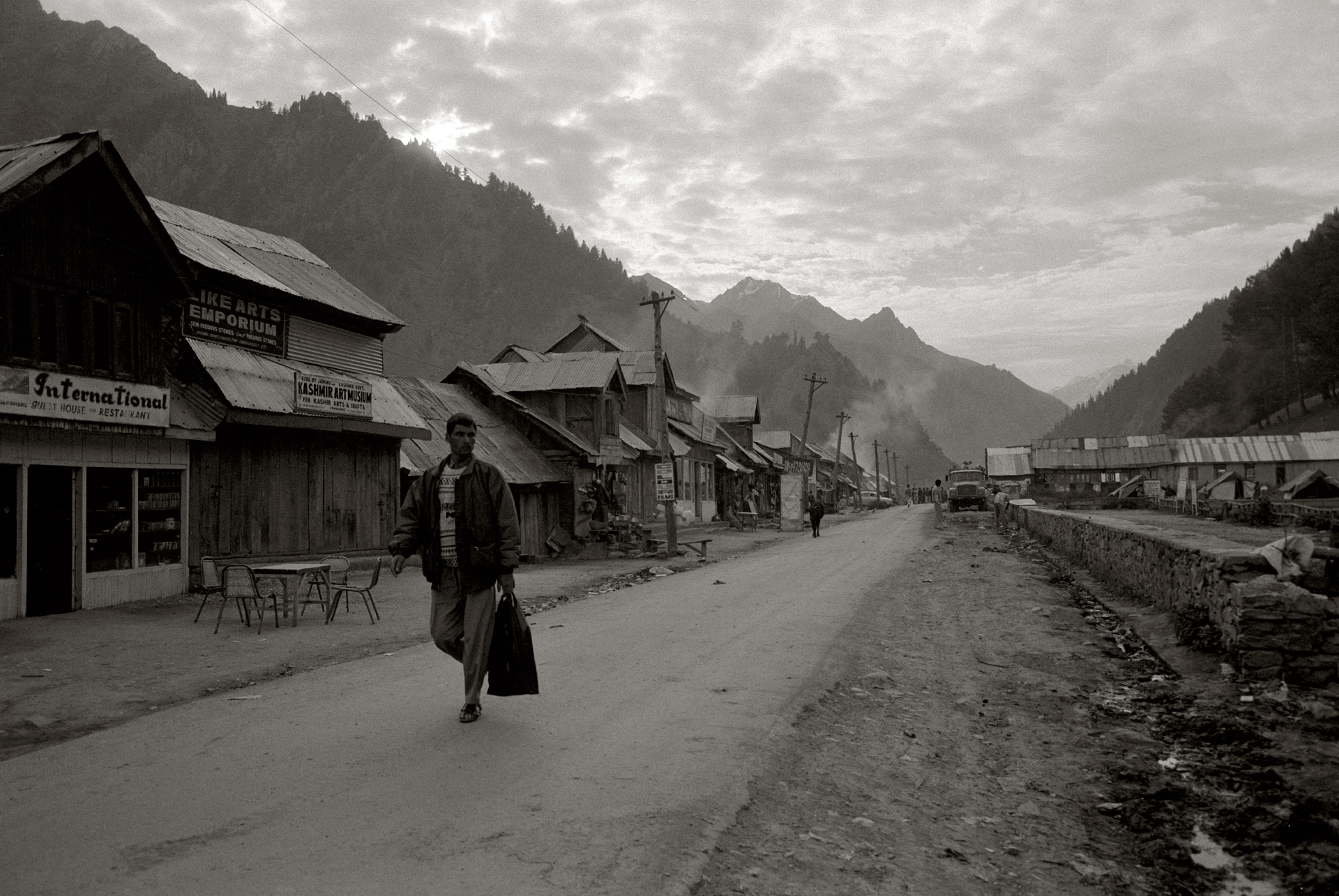 A man walking in the road in Sona Marg in Kashmir, India