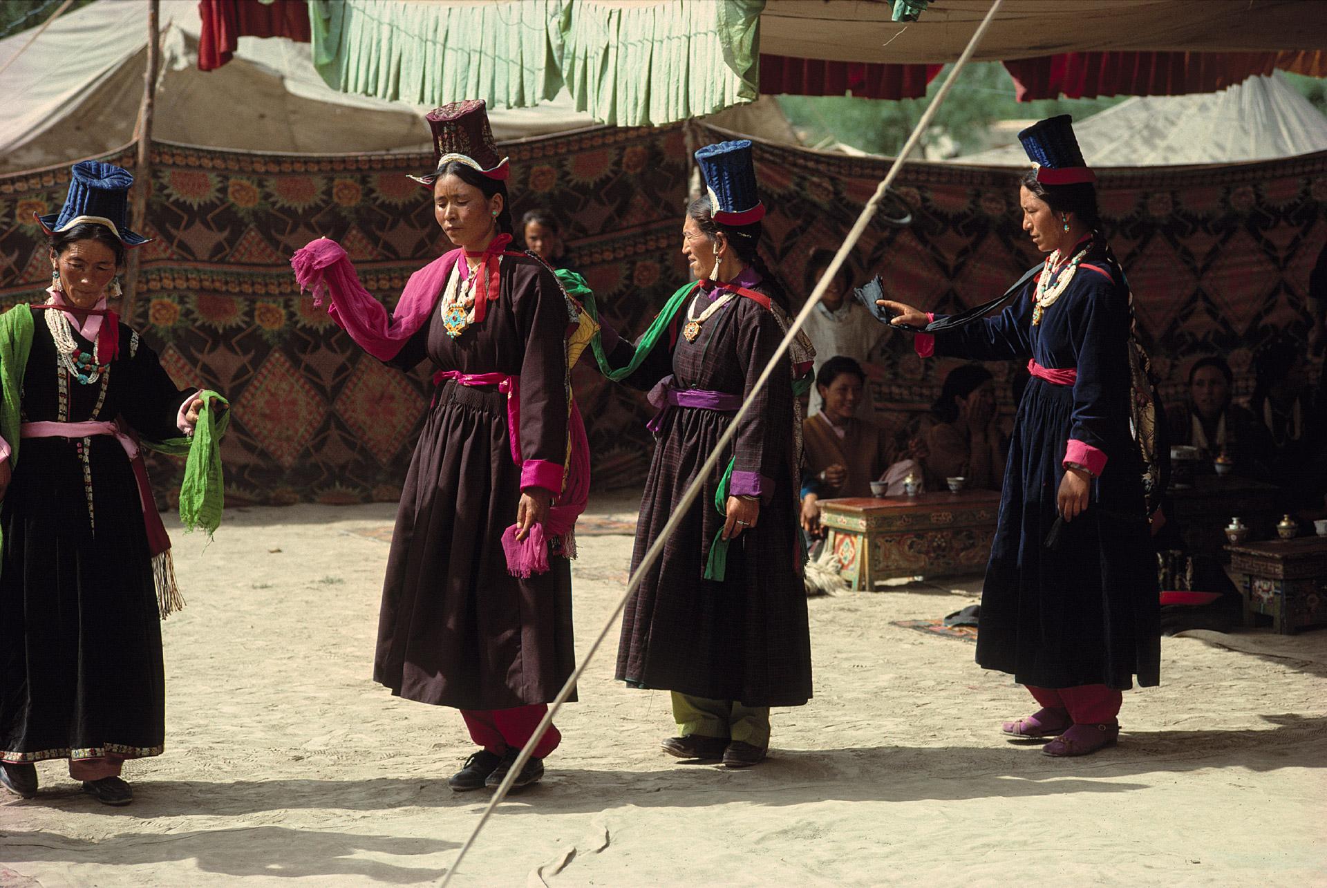 Ladakhian women perform a ceremonial dance near Thiksey Monastery in Ladakh, India